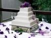 4-tier-purple-flowers-wedding-cake